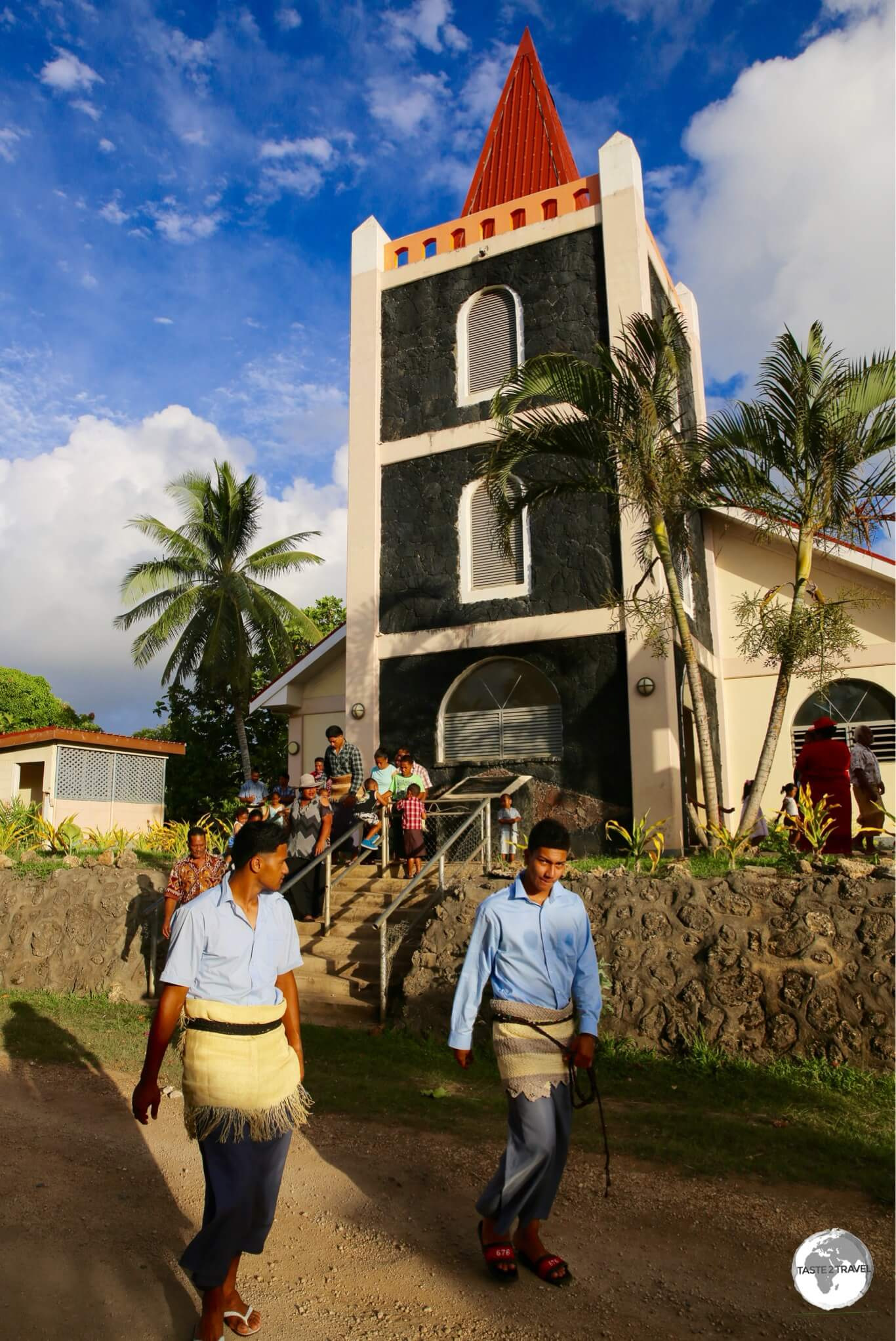 Worshiper's in traditional dress leaving a church service on 'Eua.