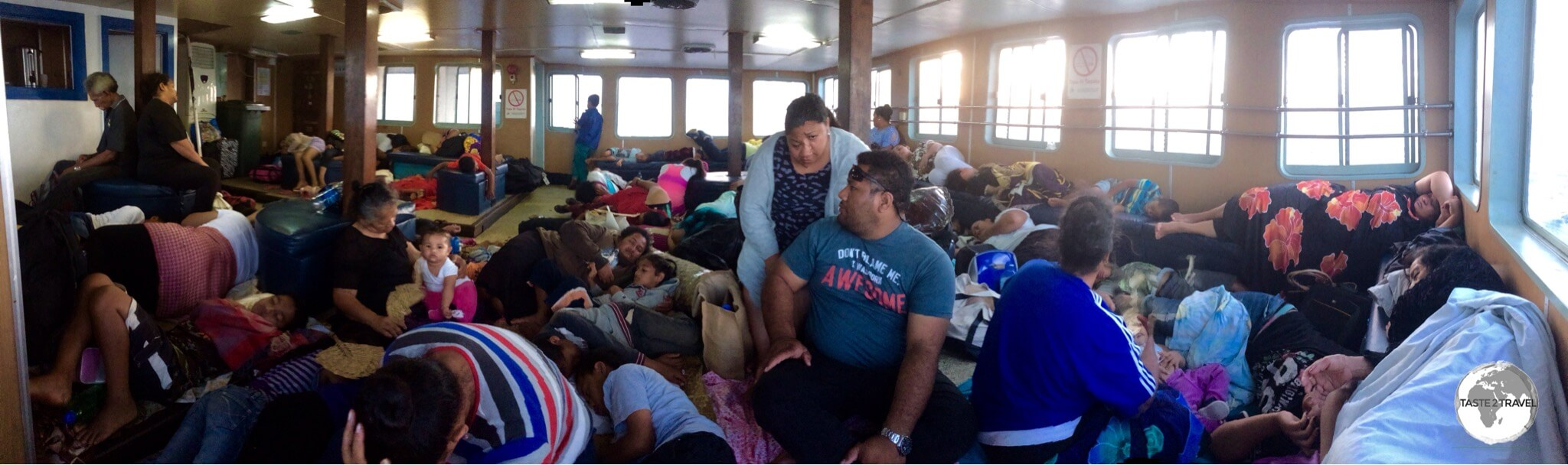 The slow car ferry can get very crowded with the Tongans preferring to lay on their mats on the floor.