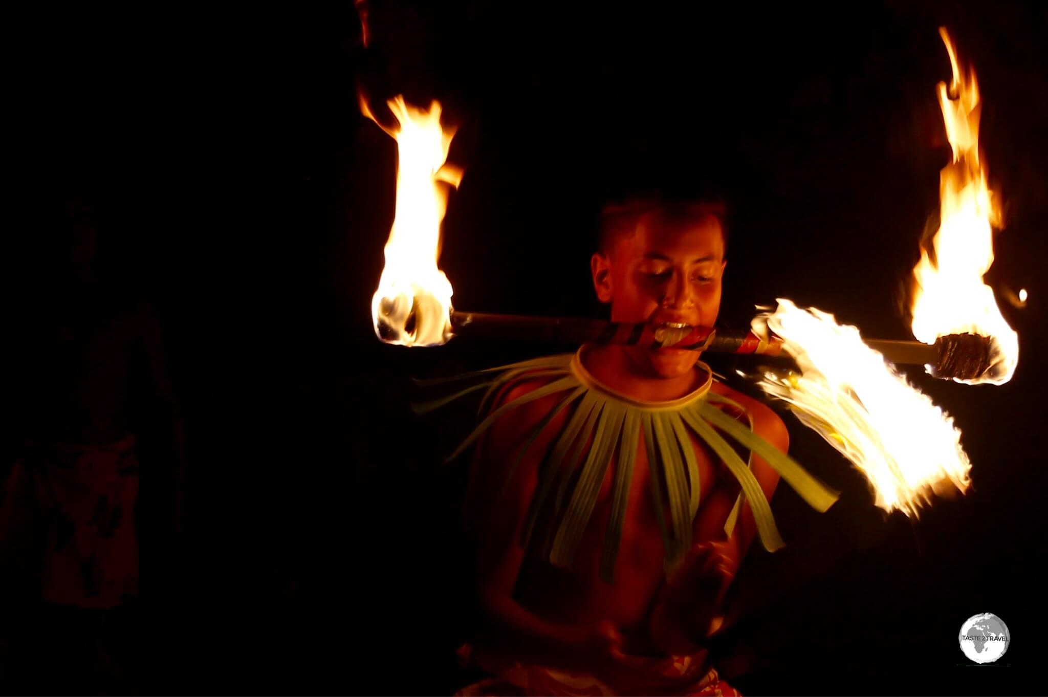 Fire dancing at Hina Cave.
