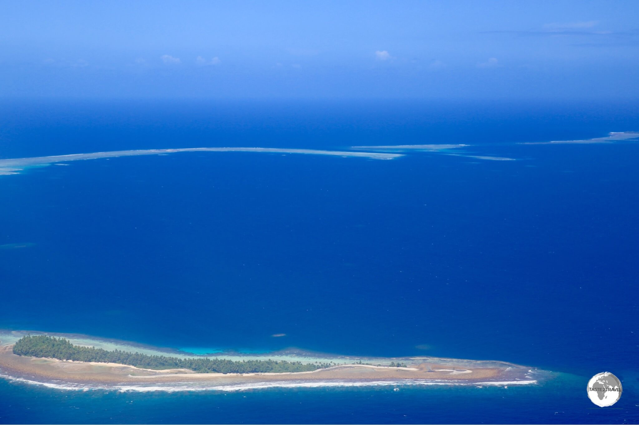 Tuvalu is comprised of narrow slivers of land surrounded by the vast blue expanse of the Pacific ocean.