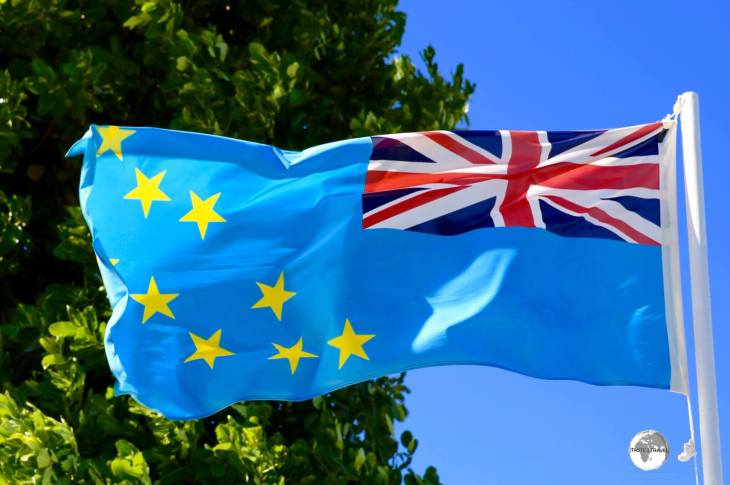 The flag of Tuvalu includes the Union Jack and nine stars representing the nine islands.