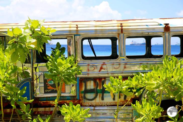Lagoon-views through the windows of an abandoned Filipino Jeepney.