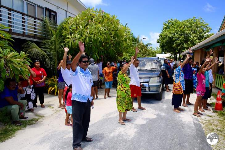 Tuvaluan's waving goodbye to departing friends and family at Funafuti International airport (with Filamona lodge in the background).