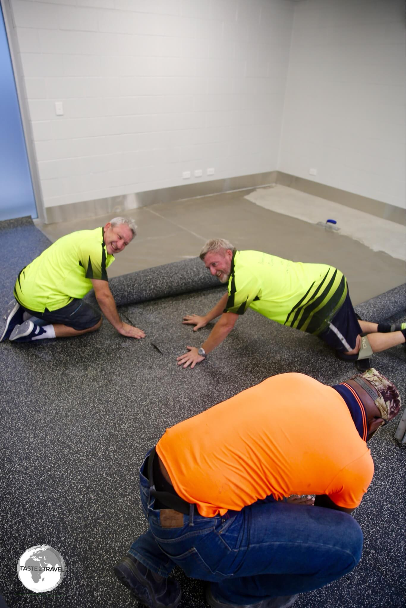 A team from Australia install the flooring in the new terminal.