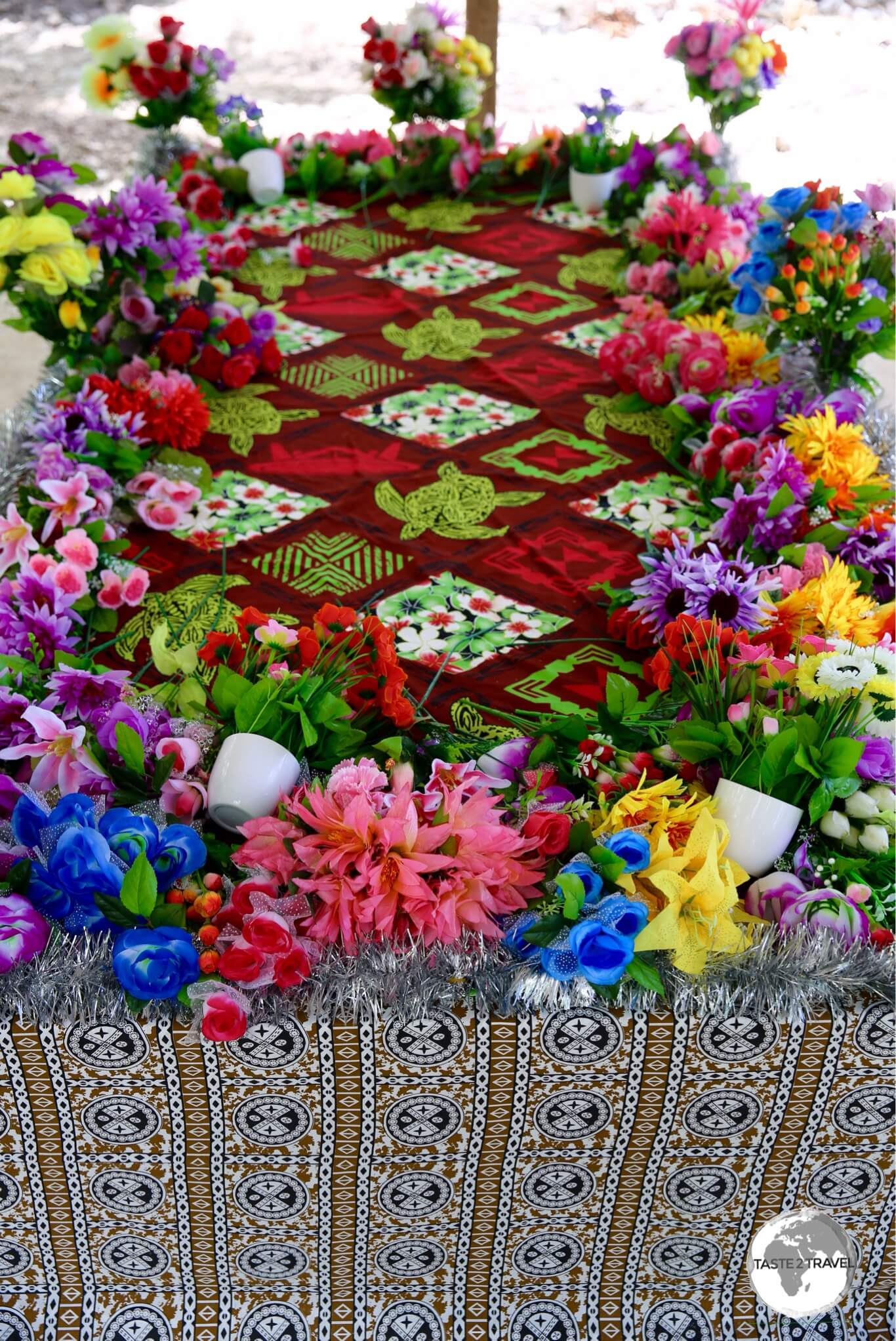A colourfully decorated grave.