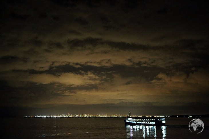The glow of bustling Belém lights up the sky as I approach on my slow boat from Santerem - the end of a 48 hour journey.