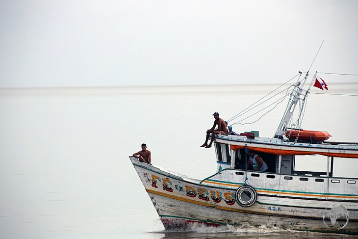 A boat cruising on the wide mouth of the Amazon River near Macapá.