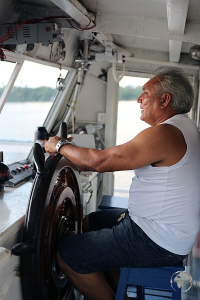 The captain of the M/V Sao Francisco de Paula steering a course to Macapá.