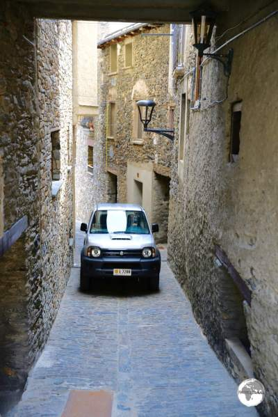 Car in lane way, Ordino village, Andorra.