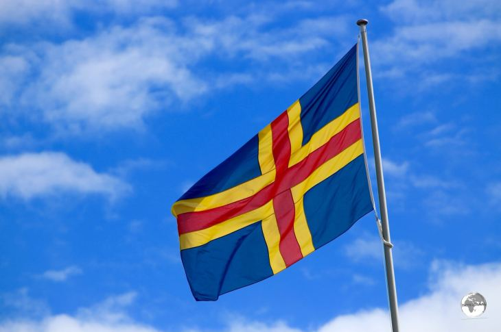 The flag of the Åland Islands flying outside parliament in Mariehamn.