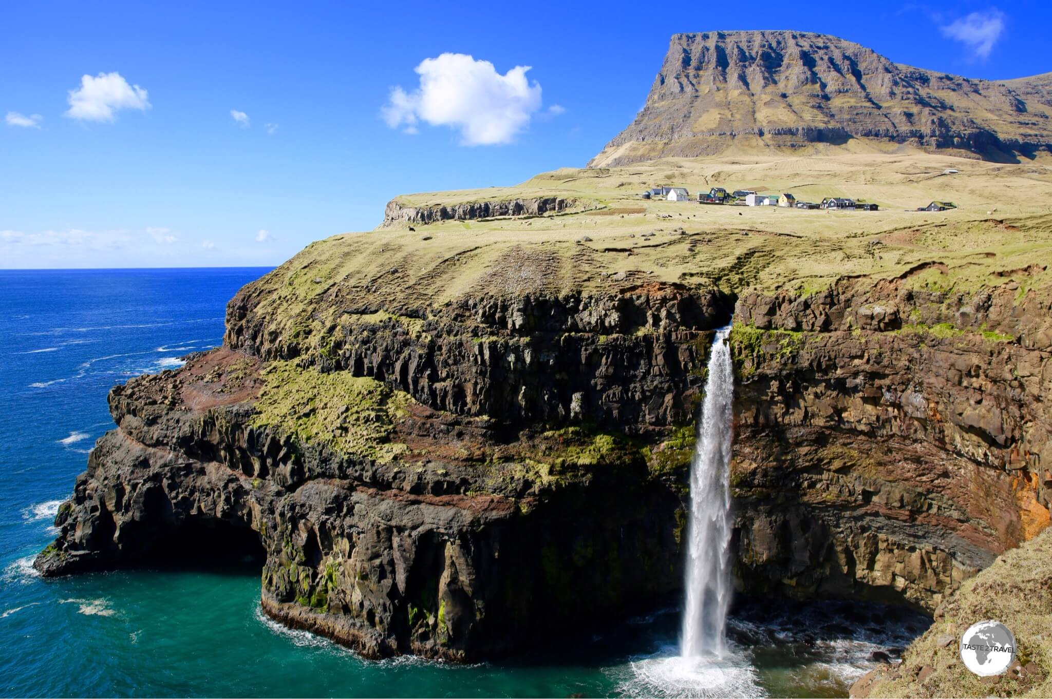 Mulafossur Waterfall plunges 60 metres into the Atlantic Ocean.