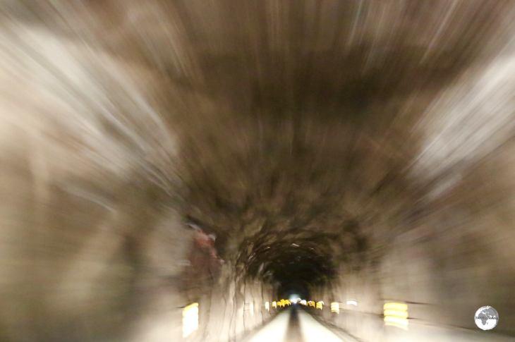 Driving through the 2.2 km long Hvannasundstunnilin (Hvannasund Tunnel) on Bordoy Island.