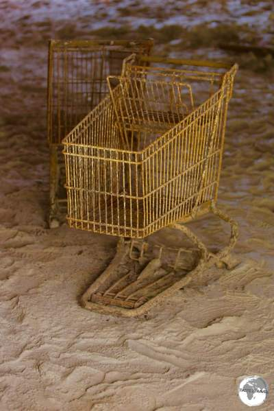Trolleys, covered in volcano ash, remain where they were left in the former Angelo's supermarket in Plymouth.