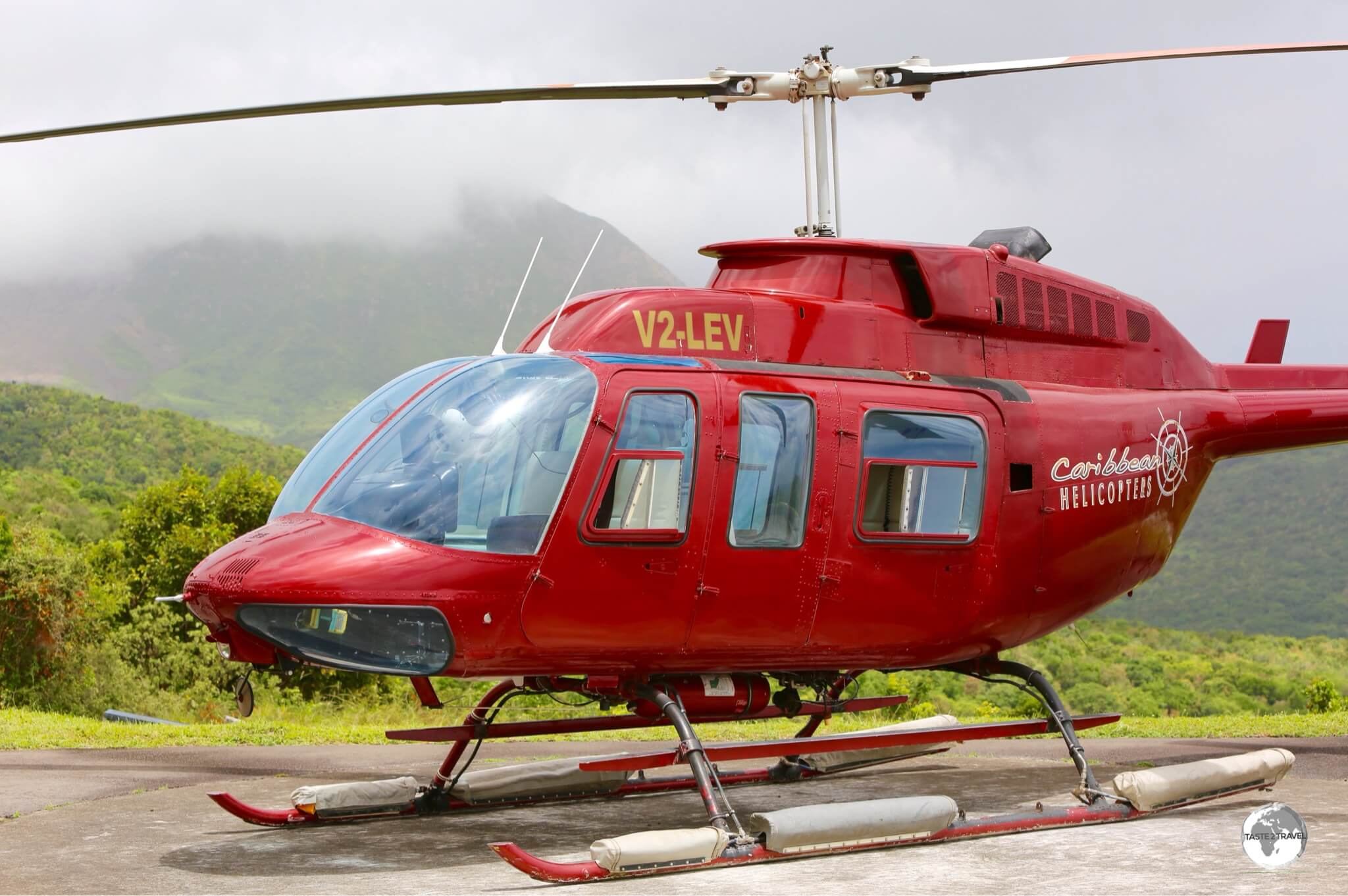 Scientists at the Montserrat Volcano Observatory monitor the volcano using different means including a helicopter.