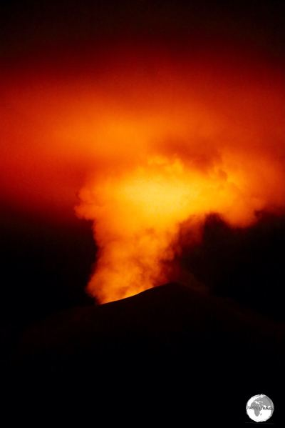 The night-time glow from the Mount Yasur volcano illuminates the night sky.