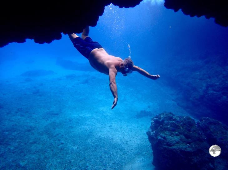 Yours truly making a graceful entry into the Blue Cave.