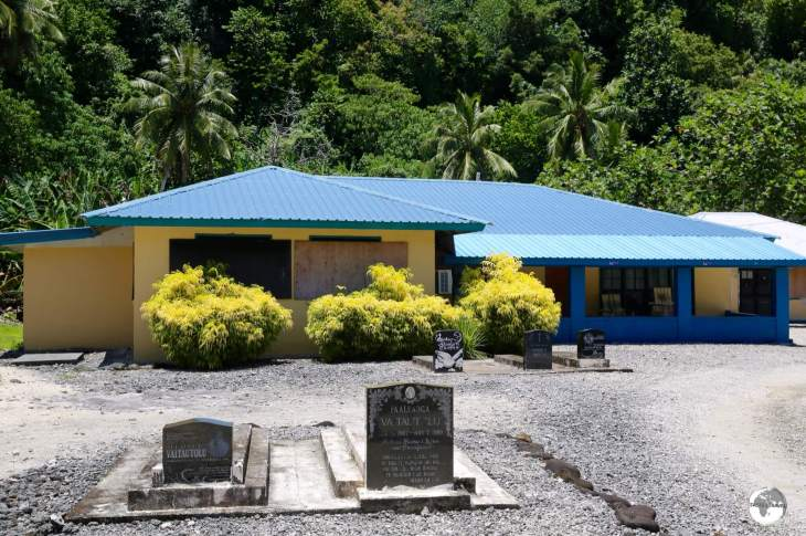 My family homestay on the island of Ta'u. As is customary in Polynesia, deceased relatives are buried in the front garden.
