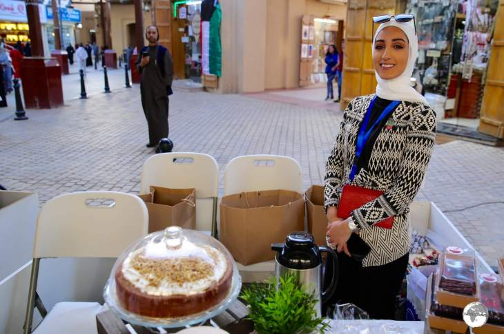 The proud owner of a market stall who happens to makes one of the best carrot cakes in Kuwait.