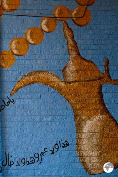 Tea-pot artwork adorns the wall at Souk Al-Mubarakiya.