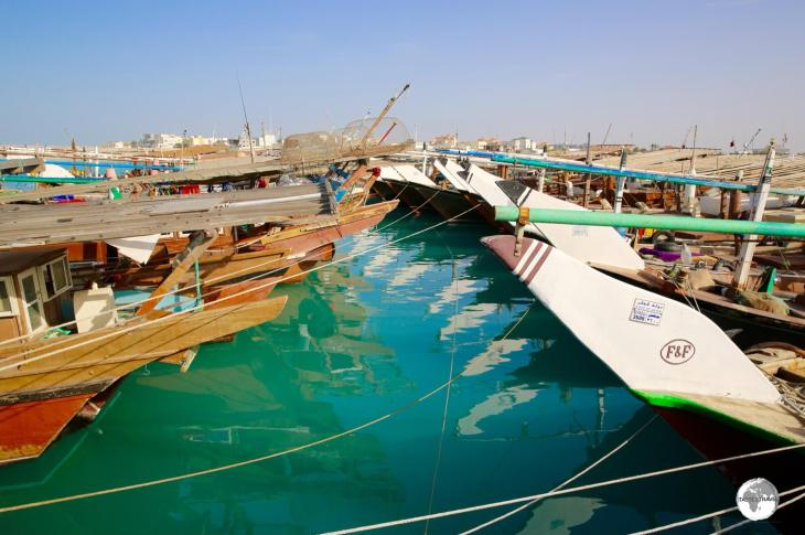 The dhow harbour in Al Ruwais is home to a large fleet of fishing boats.