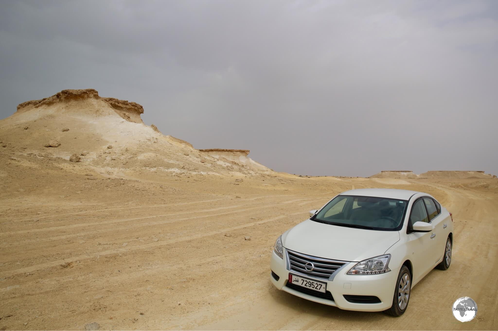 Off road in my rental car, exploring the landscapes near Zekreet.