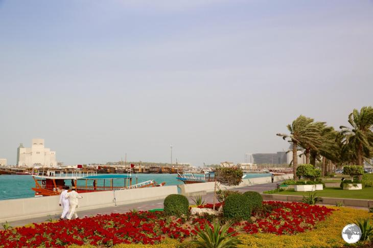 The 7-km long Doha Corniche is lined with flower beds, palm trees and planted grass.