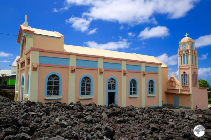 A side view of the <i>Église Notre Dame des Laves</i> better illustrates its position in the lava field.