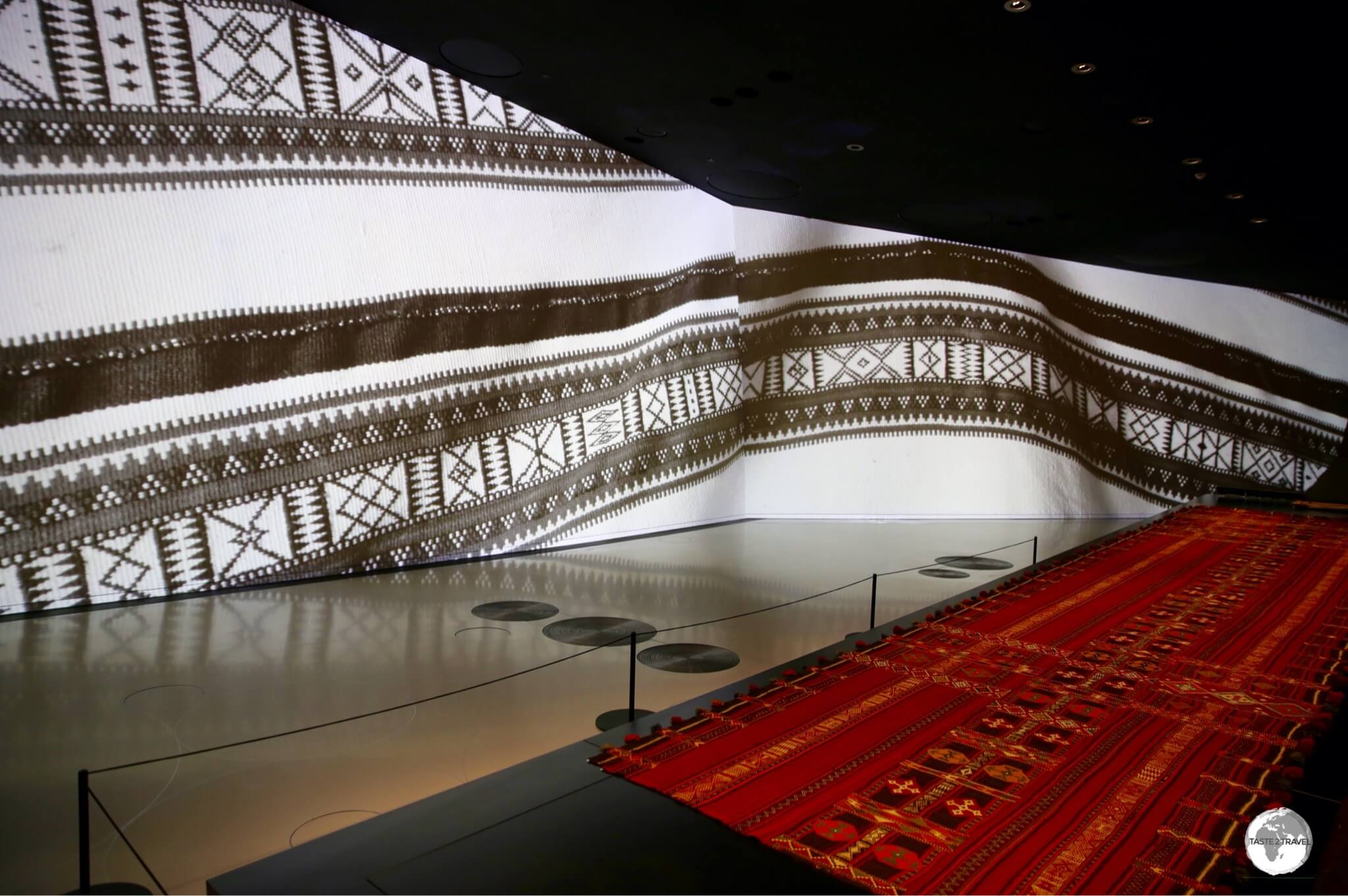 The large, curved walls of the galleries are used to project images which enhance the various displays.