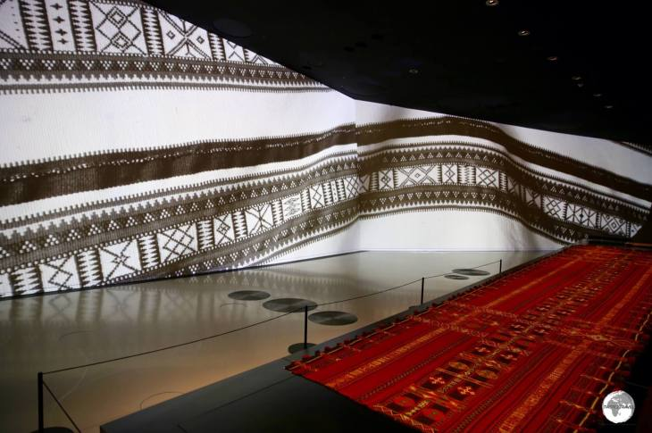 The large, curved walls of the National Museum of Qatar are used to project images which enhance the various displays.