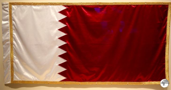 The Qatar flag displayed in the National Museum of Qatar.