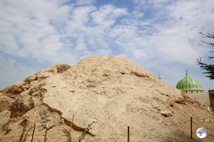 One of the 17 royal mounds that lie among the urban sprawl of A'Ali township.
