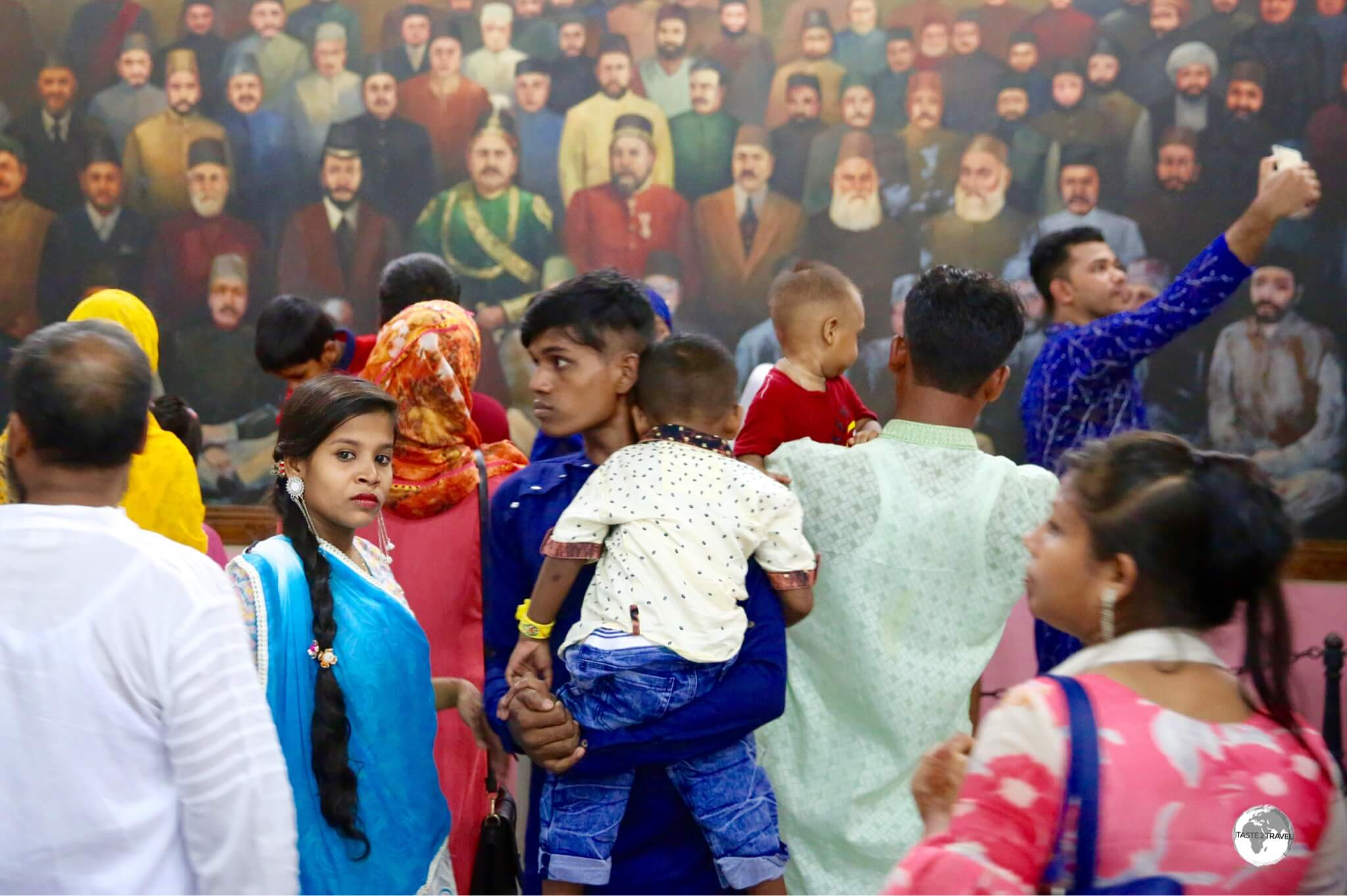 Bangladeshi visitor's observing a mural of Bangladeshi leaders inside the Pink Palace museum.