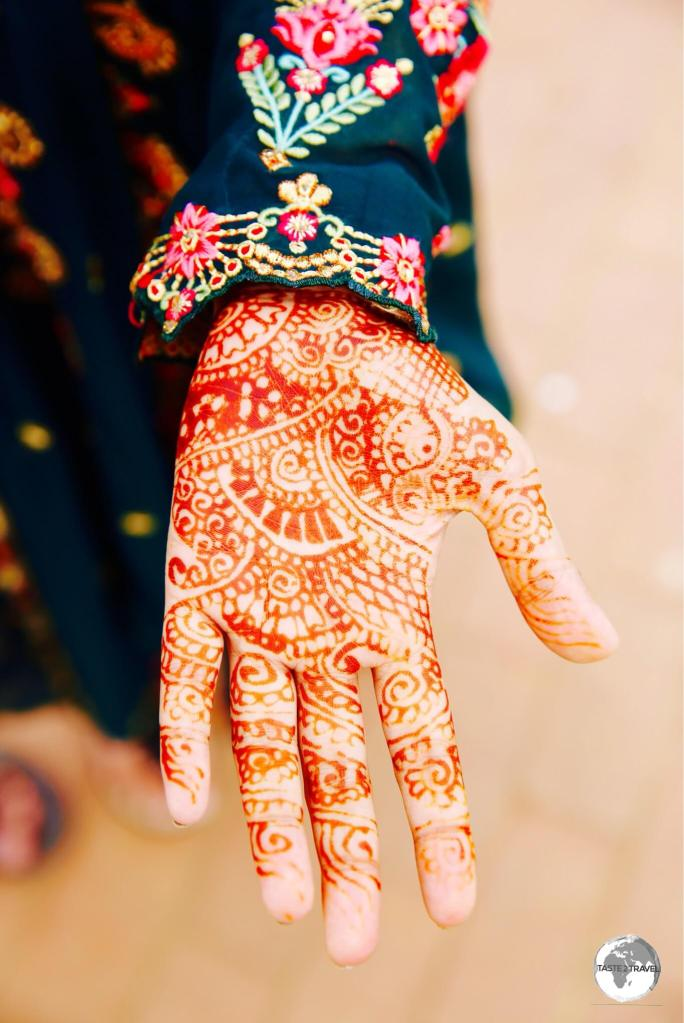 Decorative hand designs made from powdered henna are popular with Bangladeshi woman.
