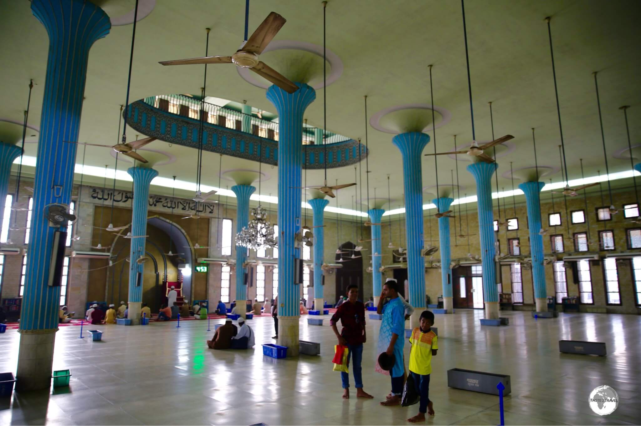 Turquoise-coloured columns provide a splash of colour in the otherwise austere interior of the Baitul Mukarram mosque.