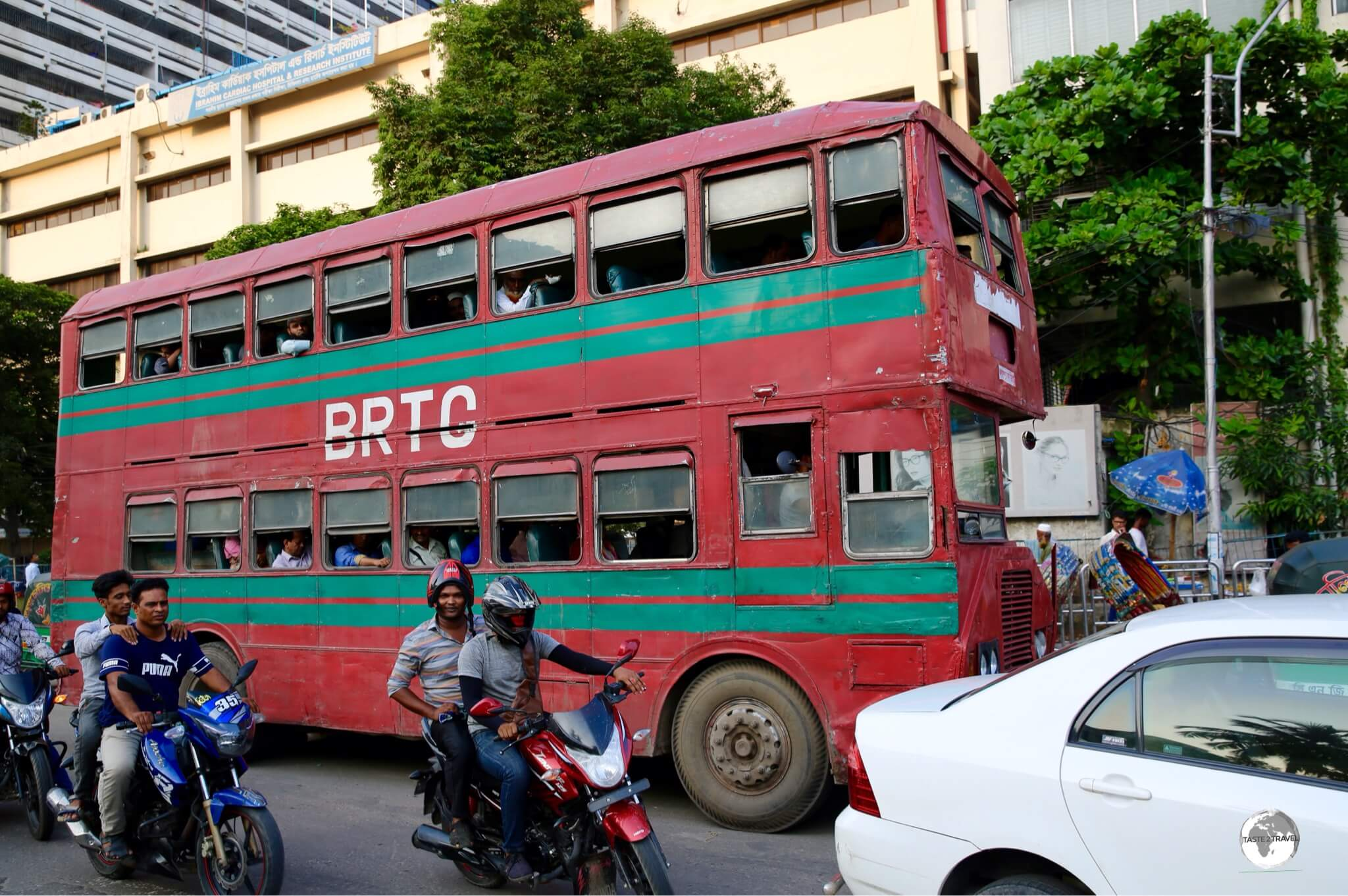 No – it's not London! Very old and beaten, red, double-decker buses ply the streets of Dhaka.