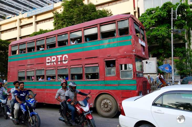 No - it's not London! Very old and beaten, red, double-decker buses ply the streets of Dhaka.