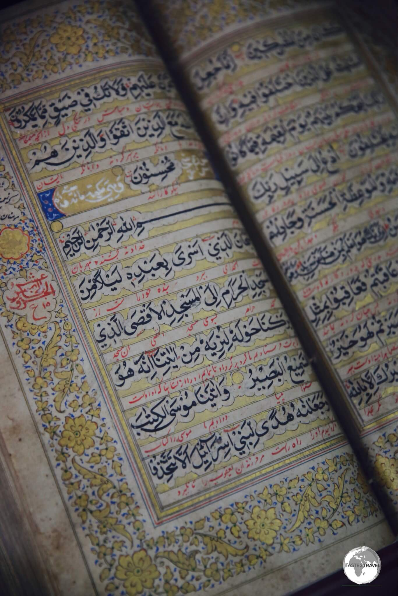 A sad sight - ancient hand-written, gold leaf, Islamic manuscripts rotting away in the humid heat.