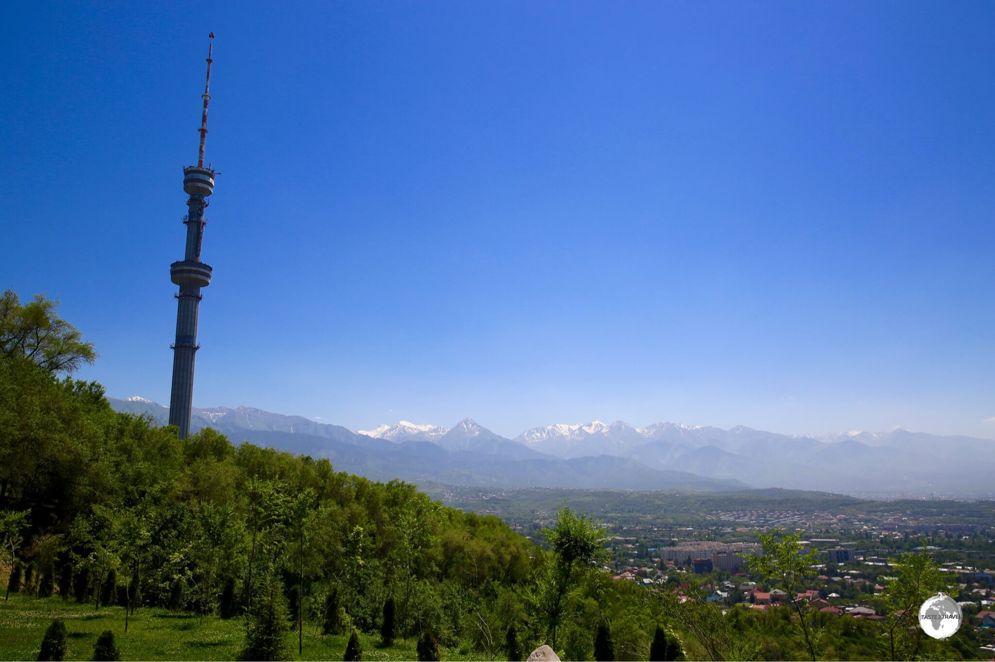A view of the 372 metre TV tower and the Tian Shan mountains from Kok Tobe.