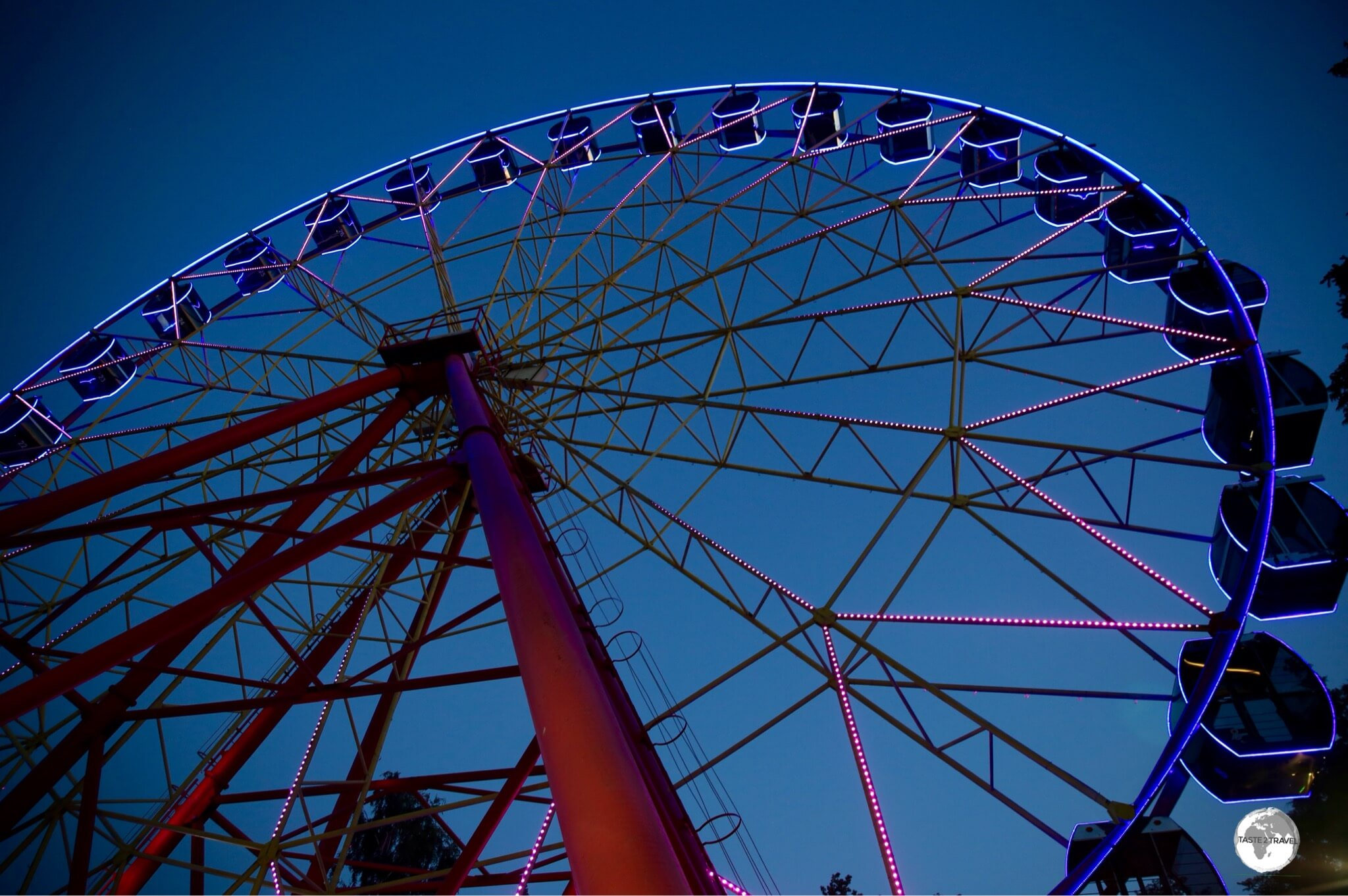 The Ferris wheel is one of many affordable amusements at Panfilov park.