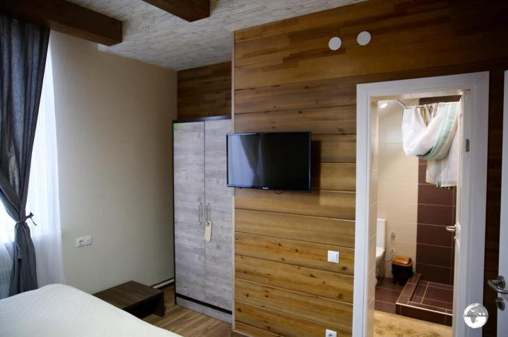 The spotlessly clean rooms at the <i>Hillside Four Seasons</i> in Karakol feature modern bathrooms, wood-panelled walls and wooden floors.