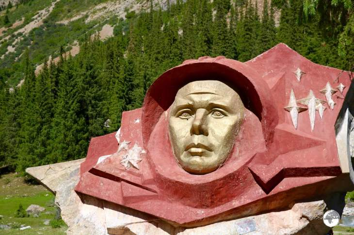The face of the famous Russian cosmonaut, <i>Yuri Gagarin</i>, is carved into a boulder in the Barskoon valley.