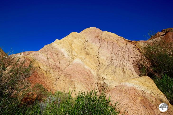 The colourful earth of the canyon contrasts brilliantly against the blue sky.