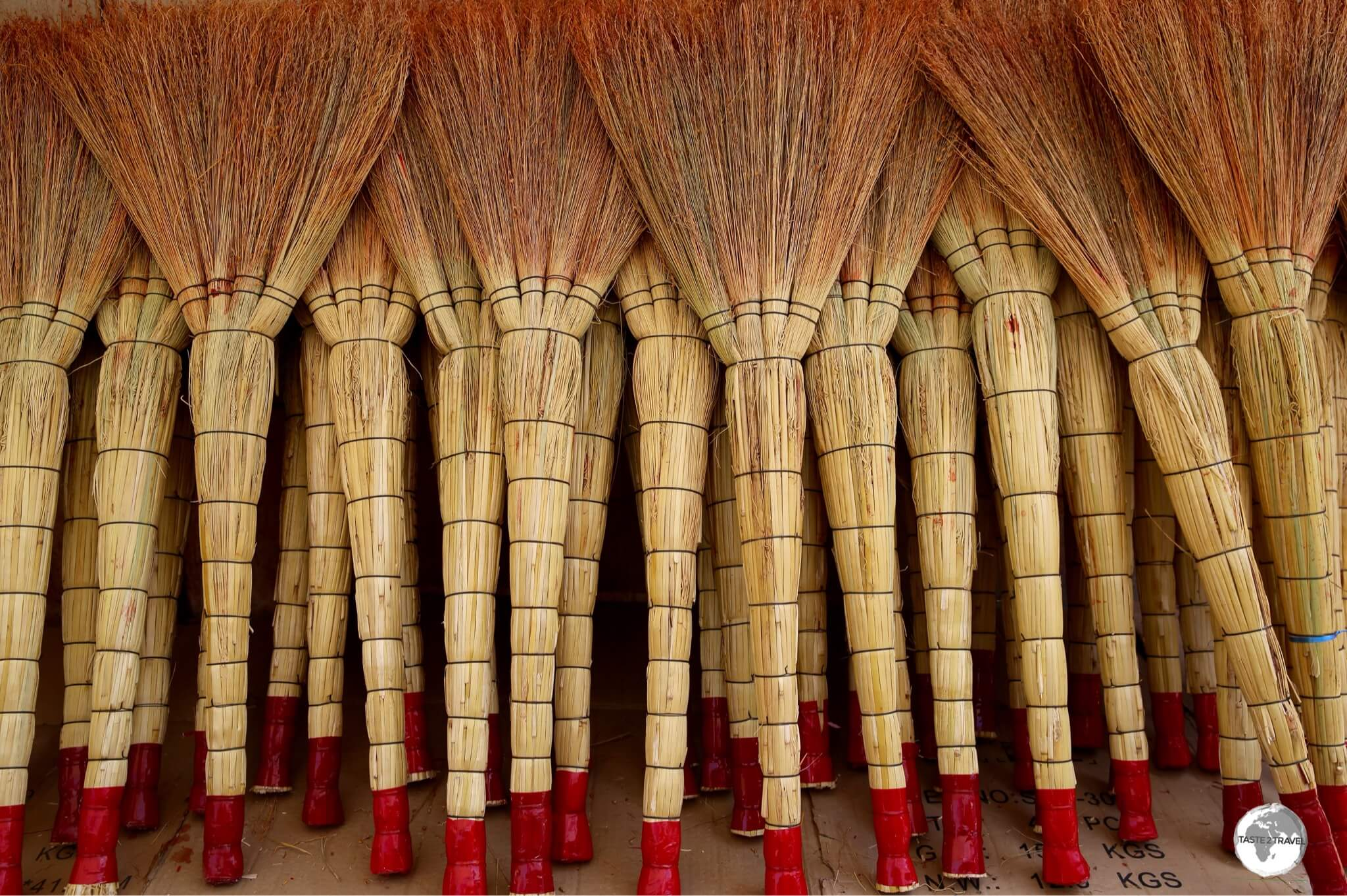 Handmade brooms for sale at the sprawling Osh bazaar.