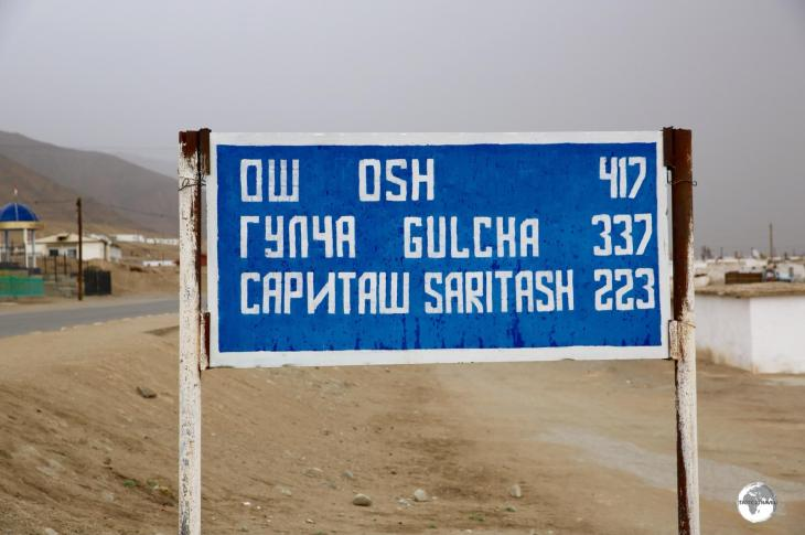 A road sign in Murgab indicates distances to towns which lie north along the Pamir Highway.