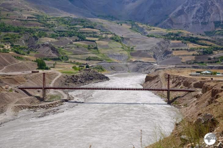 The Tajikistan-Afghanistan Friendship Bridge spans the Panj river at Darvaz.