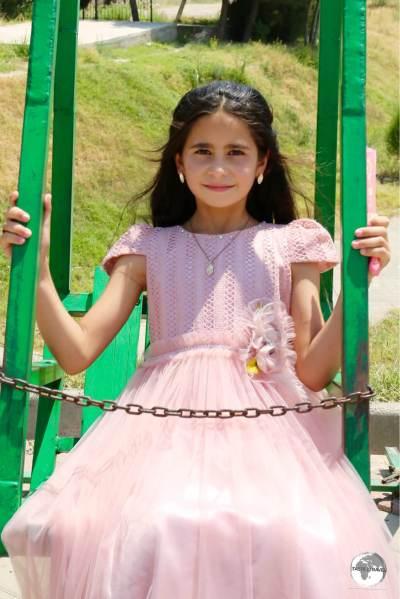 A young Tajik girl, enjoying a day out at Hissar.