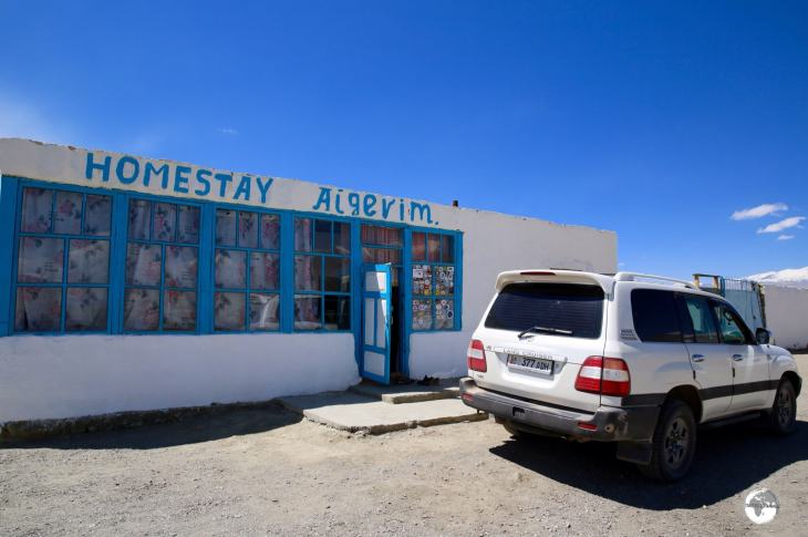 My driver checked us into the 'deluxe' digs at Homestay Aigerim on the shores of Lake Karakul.