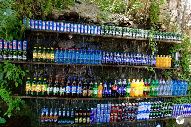A novel concept for an outdoor drinks shop – drinks are kept cool under the flow of a trickling waterfall.