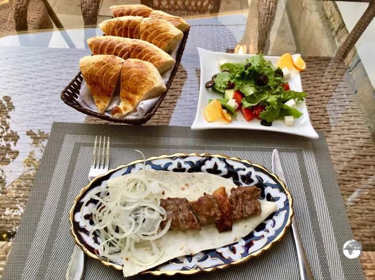 """A delicious dinner at Restaurant ''Old Bukhara"""" - shashlik, Greek salad and fresh Bukhara bread."""