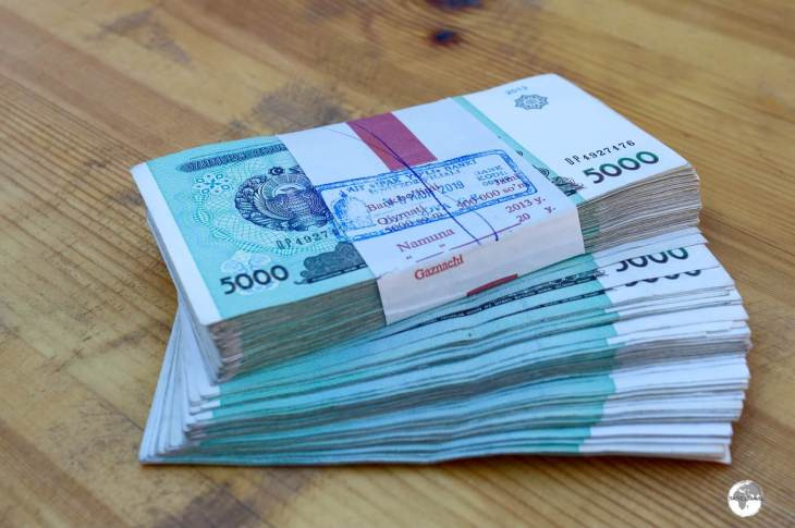 My wad of 5,000 som notes, which were handed to me at the bank after I changed USD$100.